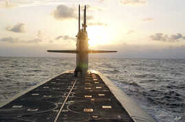 FILE - The ballistic-missile submarine USS Wyoming is seen in the Atlantic, in this photo released by the U.S. Navy Jan. 9, 2008. The U.S. military says it is deploying long-range missiles armed with a nuclear warhead of reduced destructive power.