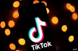 This photo taken on November 21, 2019, shows the logo of the social media video sharing app Tiktok displayed on a tablet screen…