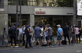 Journalists gather outside the private health center where the first Argentine infected with the new Coronavirus, COVID-19, is…
