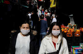 People wear protective face masks due to coronavirus concerns in Istanbul, Turkey, March 13, 2020.