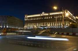 In this photo taken on Monday, July 24, 2017, a car passes the building of the Federal Security Service (FSB, Soviet KGB…
