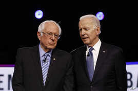 From left, Democratic presidential candidates, Sen. Bernie Sanders, I-Vt., former Vice President Joe Biden, talk