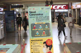 An information banner on the new coronavirus stands at a train station in Jakarta, Indonesia, March 2, 2020.