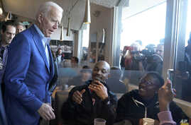 Democratic presidential candidate former Vice President Joe Biden talks with customers at the Buttercup Diner during a campaign…