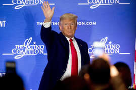 President Donald Trump waves after speaking at the Latino Coalition Legislative Summit at the JW Marriott, Wednesday, March 4,…