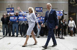 Democratic presidential candidate former Vice President Joe Biden, accompanied by his wife Jill arrives to speak to members of the press at the National Constitution Center in Philadelphia, March 10, 2020.