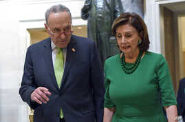 Senate Minority Leader Sen. Chuck Schumer of N.Y., and House Speaker Nancy Pelosi of Calif., walk together