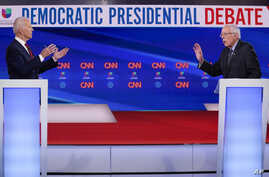 Former Vice President Joe Biden, left, and Sen. Bernie Sanders, I-Vt., right, participate in a Democratic presidential debate