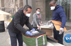 Restaurateur Luca Di Pietro (left) delivers free meals to a New York hospital.