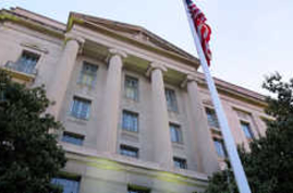 FILE - A May 14, 2013 file photo shows the Department of Justice headquarters building in Washington. The Justice Department…