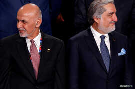 FILE PHOTO: Afghanistan's President Ashraf Ghani (L) and Afghanistan's Chief Executive Abdullah Abdullah (R) participate in a…