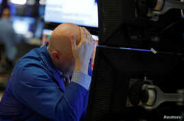 A trader works on the floor of the New York Stock Exchange (NYSE) in New York City, New York, U.S., March 11, 2020.