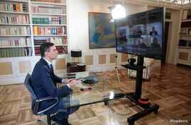 Spanish Prime Minister Pedro Sanchez holds a videoconference with some of his ministers over the coronavirus outbreak, at the…