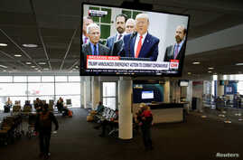 President Donald Trump is pictured on a television at Seattle-Tacoma International Airport as he declares a national emergency over the coronavirus, in SeaTac Washington, March 13, 2020.