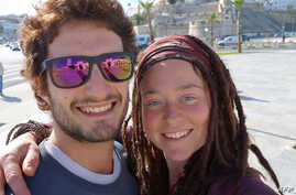 FILE - In this photograph published Jan. 17, 2019, on a Facebook page dedicated to their disappearance, Luca Tacchetto (L) and Edith Blais pose for a selfie at an unknown location.