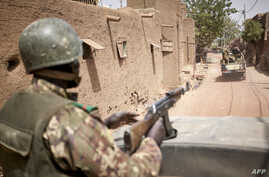 Troops of the Malian army patrol the ancient town of Djenne in central Mali, Feb. 28, 2020.