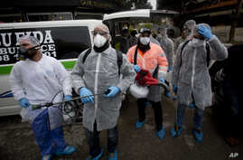 Palestinians workers in a protective suits get ready to disinfect mosques and churches as a preventive measure against the coronavirus in the West Bank city of Ramallah, March 7, 2020.