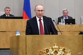 FILE - Russian President Vladimir Putin speaks during a session of the State Duma, the Lower House of the Russian Parliament, prior to its members voting on constitutional amendments, in Moscow, Russia, March 10, 2020.