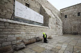 A pilgrim prays outside the Church of the Nativity in Bethlehem, West Bank, March 5, 2020.