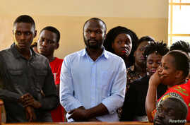 Ugandan independent filmmaker Moses Bwayo stands in the dock at the Makindye Magistrate Court, in Kampala, Uganda, March 4, 2020.