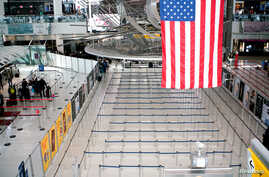 The lines to reach TSA immigraThe lines to reach TSA immigration process are seen empty at one of its terminals at the John F. Kennedy International Airport in New York, March 9, 2020.tion process are seen empty at one of its terminals at the John F. Kennedy International Airport…