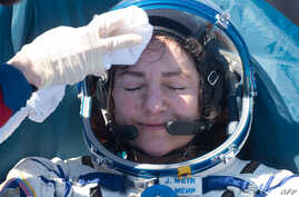 NASA astronaut Jessica Meir rests shortly after landing in a remote area outside the town of Dzhezkazgan (Zhezkazgan),…