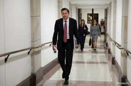 FILE - Intelligence Community Inspector General Michael Atkinson departs after testifying at a House Intelligence Committee closed-door hearing on a whistleblower complaint about President Donald Trump's dealings with Ukraine, on Capitol Hill in Washington, Oct. 4, 2019.