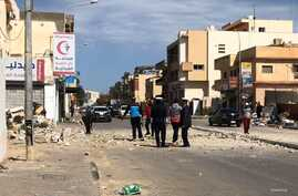 Locals examine a street recently hit by a bomb in Tripoli, Libya, March 27, 2020. (Courtesy of resident Mohammed Kikly)