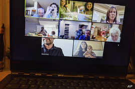 In this April 8, 2020, photo, Tali Arbel and her family and friends from other places are pictured on a New York computer.