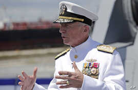 FILE - In this  July 27, 2019 file photo, Admiral Craig Faller, commander of U.S. Southern Command, speaks with the news media…