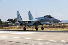 FILE - This Sept. 26, 2019 file photo, shows a Russian Su-35 fighter jet taking off at Hemeimeem air base in Syria. In a world…