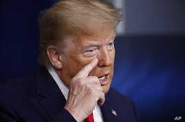 President Donald Trump gestures as he talks about the first coronavirus test he had during a coronavirus task force briefing at the White House, Saturday, April 18, 2020, in Washington.