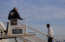 FILE - A to-be-deported illegal immigrant from Latin America boards a flight chartered by U.S. Immigration and Customs Enforcement, in Houston, Texas, Nov. 16, 2018.