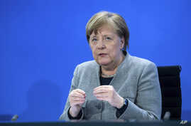 Germany's Chancellor Angela Merkel speaks at a press conference in the Federal Chancellery, Berlin, April 15, 2020.