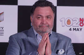 FILE - Bollywood actor Rishi Kapoor greets the media as he arrives for the song launch of the film '102 Not Out,' in Mumbai, India, April 19, 2018. He died Thursday at age 67.