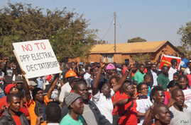 FILE - Demonstrators march along a street protesting May election results during a rally in Malawi's capital Lilongwe. Despite the coronavirus spread, a re-run of the vote is now scheduled for July. (Lameck Masina/VOA)