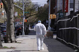 A doctor walks outside the Wyckoff Heights Medical Center during the outbreak of the coronavirus, in the Brooklyn borough of New York City, New York, April 10, 2020.
