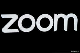 FILE - The Zoom Video Communications logo is pictured at the NASDAQ MarketSite in New York, April 18, 2019.