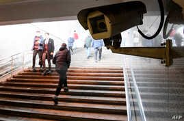 A picture shows a surveillance camera in an underground passage in Moscow on January 27, 2020. - A vast and contentious network…