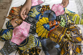 Face masks made by Sheila Notewo, a young Cameroonian woman, from African fabric is seen in Yaoundé on April 23, 2020. - The…