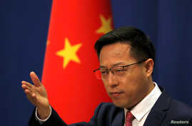 Chinese Foreign Ministry spokesman Zhao Lijian attends a news conference in Beijing, China April 8, 2020. REUTERS/Carlos Garcia…