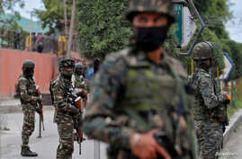 India's Central Reserve Police Force (CRPF) personnel stand guard alongside a road in Srinagar May 6, 2020. REUTERS/Danish…