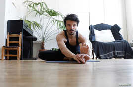 Dancer and choreographer Nicolas Maloufi practises yoga during the outbreak of the coronavirus disease (COVID-19) in Paris,…