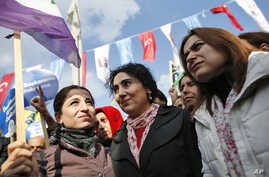 FILE - Figen Yuksekdag, center, co-chairwoman of the pro-Kurdish Peoples' Democratic Party (HDP), participates in an attempted march