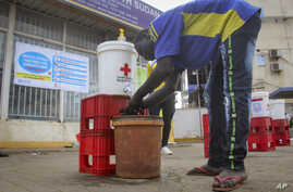 A man washes his hands to curb the spread of the new coronavirus in Juba, South Sudan, Monday, April 6, 2020. South Sudan on…