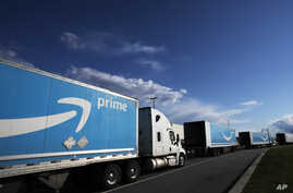 Amazon tractor trailers line up outside the Amazon Fulfillment Center, Tuesday, April 21, 2020 in the Staten Island borough of…