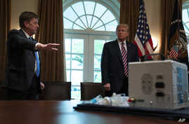 Associate director of the NASA jet propulsion laboratory Dave Gallagher shows President Donald Trump a ventilator created by…