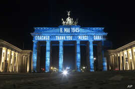 Germany's landmark the Brandenburg Gate is illuminated to mark the 75th anniversary of Victory Day and the end of World War II…
