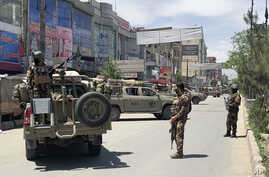 Afghan security personnel arrive at the site where gunmen attacked, in Kabul, Afghanistan, Tuesday, May 12, 2020. Gunmen…