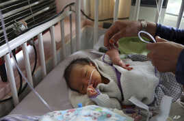 A newborn baby is cared for at the Ataturk Children's Hospital a day after being rescued from a deadly attack.